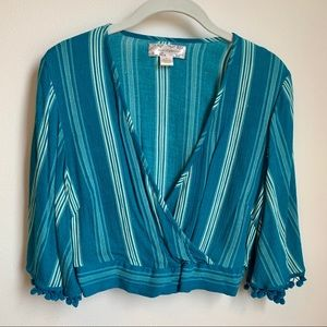 Turquoise crop top with tassel arms